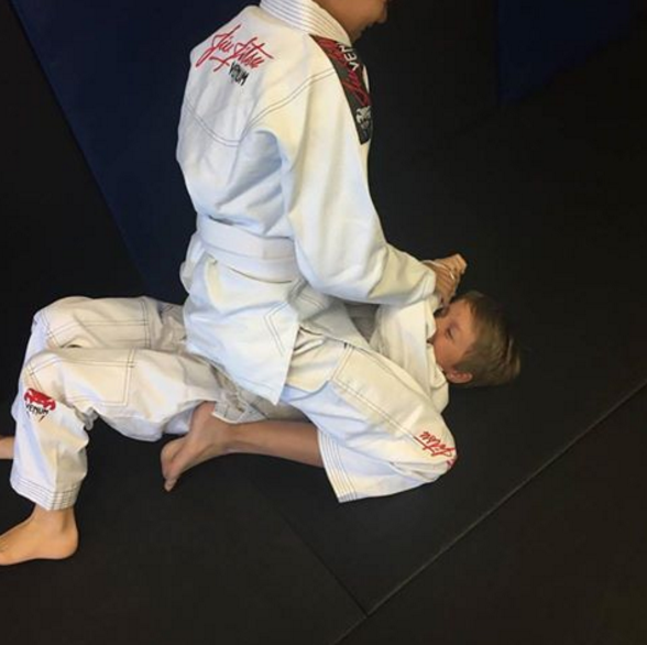 Brothers Rolling on the Jiu Jitsu Mat